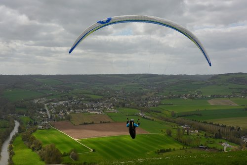 paragliding  panoramic views  paraglider ready to take off