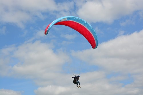 paragliding  red wing blue  sailing