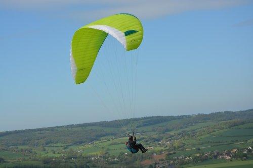 paragliding  sailing  wing yellow green