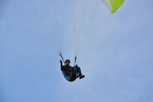 paragliding  paraglider pilots sit harness  paraglider