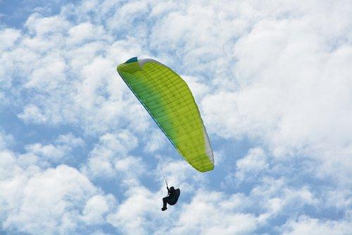 paragliding  paraglider  green sail