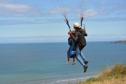 paragliding  paraglider  harness seat of a paraglider pilot