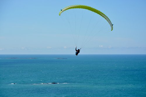 paragliding  flight over sea  sea