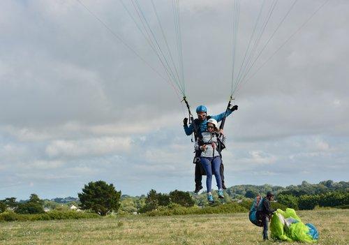 paragliding  paraglider landing  tandem paragliding