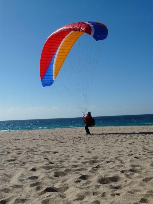 paragliding beach sea