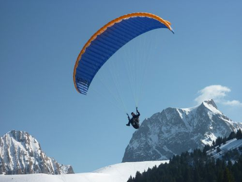 paragliding fly snow