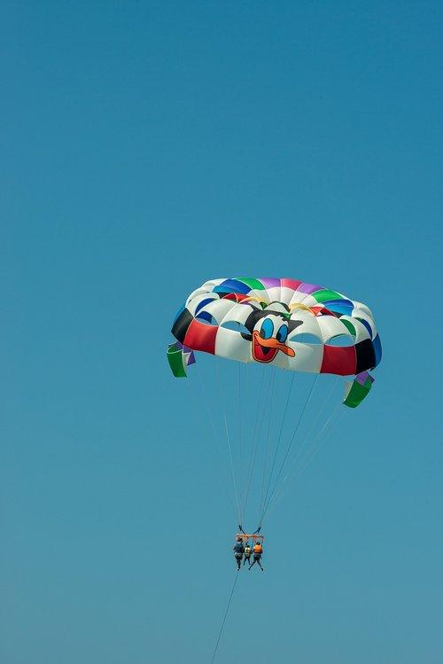 parasailing  parachute  sky