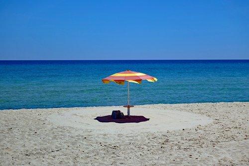 parasol  sardinia  sand