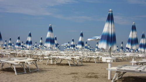 parasols sun loungers sand