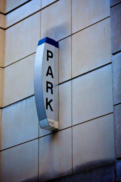 Parking Sign On Building Side