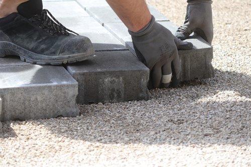 pave  composite stones  hand