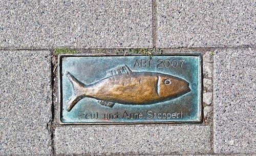 pavement  metal plate  herring motif