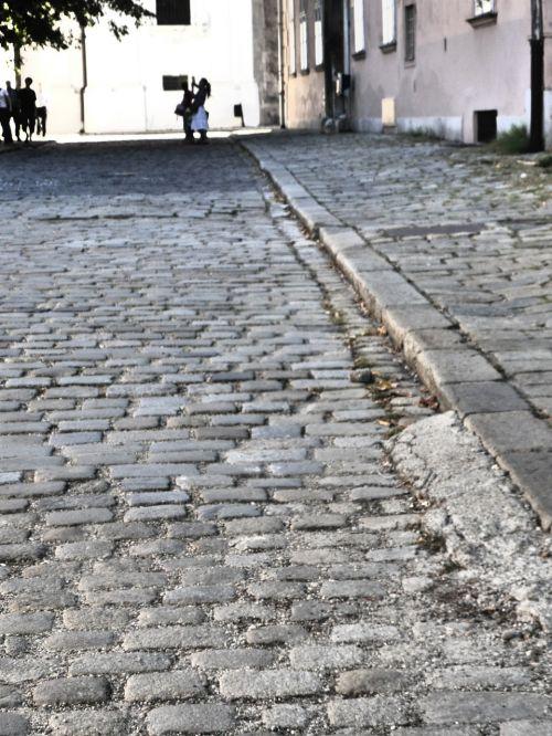 paving stones road away