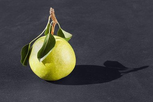 pear  black background  vitamins