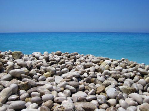 Pebbles And Sea