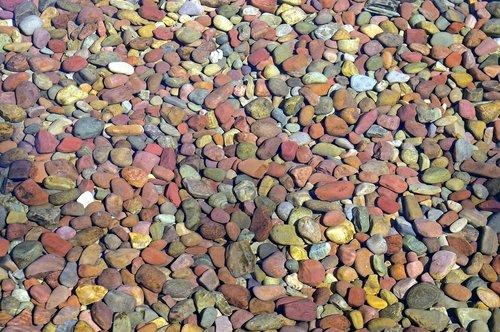 pebbles under water  stones  lake