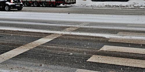 pedestrian crossing cars winter