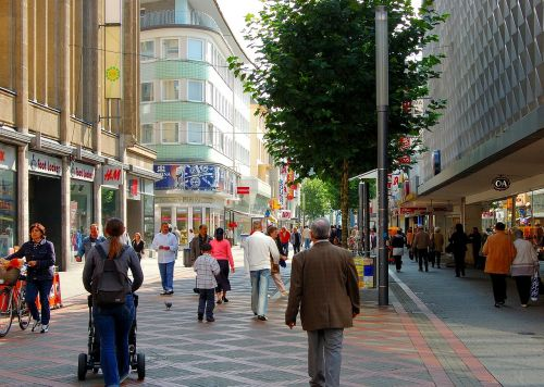 pedestrian zone shopping street passers by