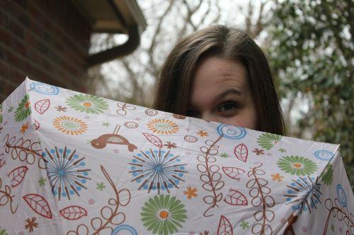 peeking umbrella girl