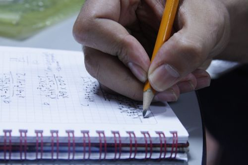 pencil hand notebook