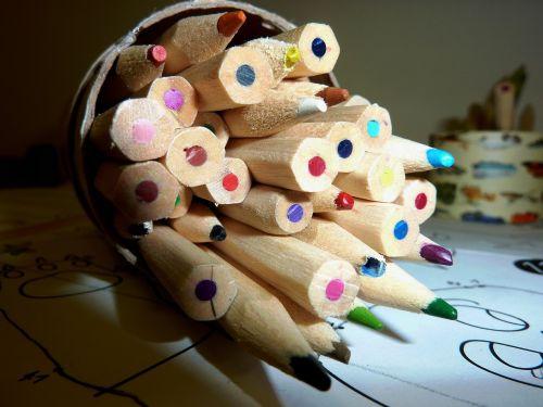 pens colored pencils paint
