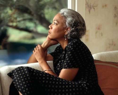 pensive female woman window