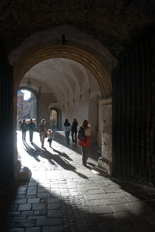 people gated cloister archway