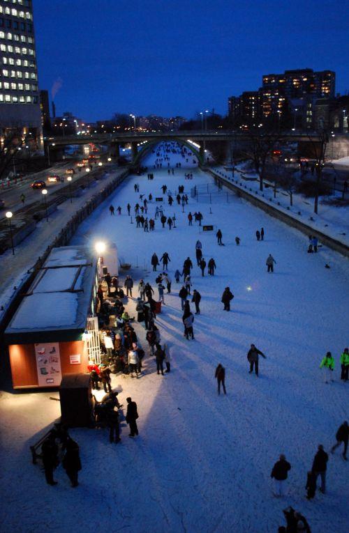 People Skating At Night