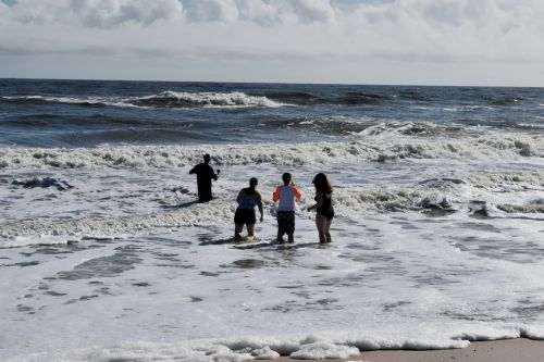 People Wading In The Ocean