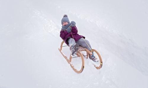 person,human,child,girl,slide,toboggan,in motion,winter,snow,out,nature