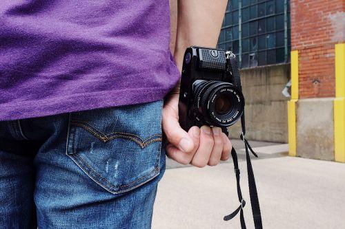 person camera photographer film
