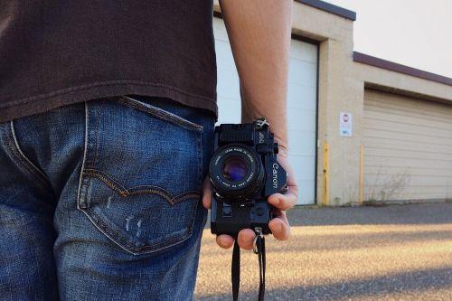 person camera photographer
