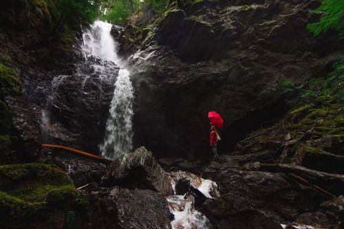 person umbrella waterfall