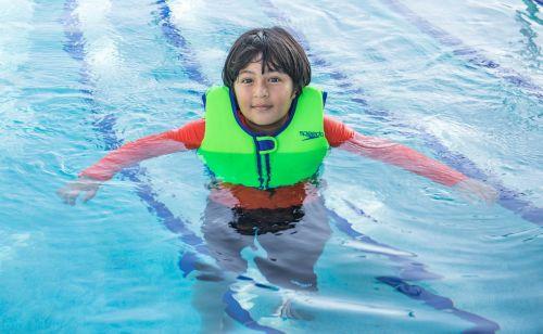 swimming life preserver boy