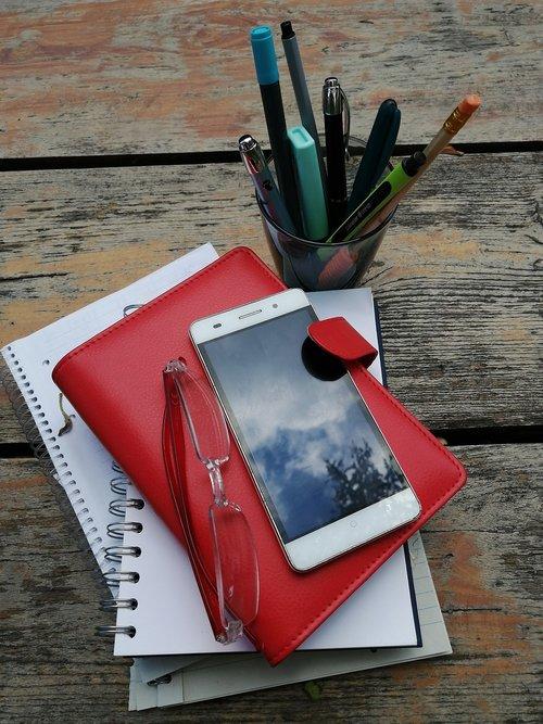 phone  diary  pencil