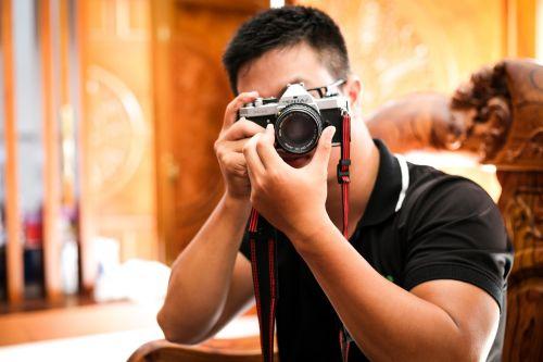 photographer taking camera