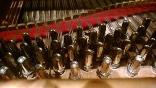 piano inside strings
