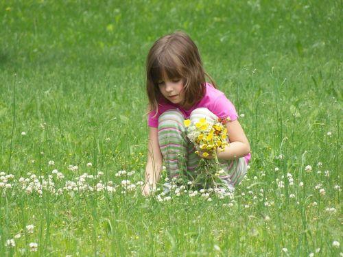 picking flowers girl child