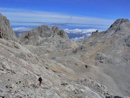 picos de europa mountaineering clouds