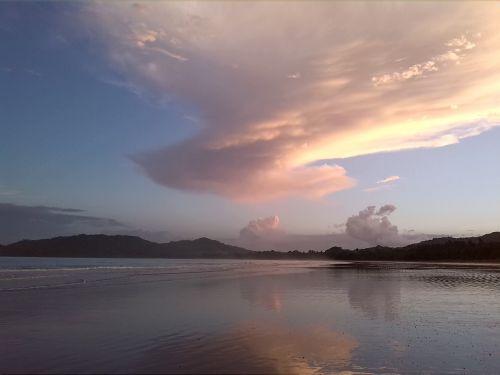 Pinkish Evening Light On Beach
