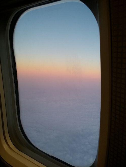 plane sky porthole