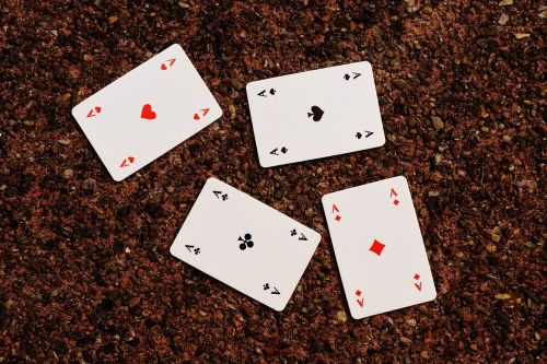 playing cards aces four