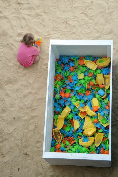 playing child sand sand toys