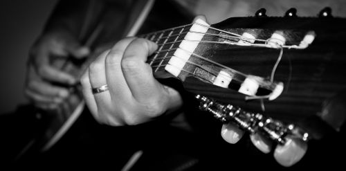 playing guitar guitar black and white