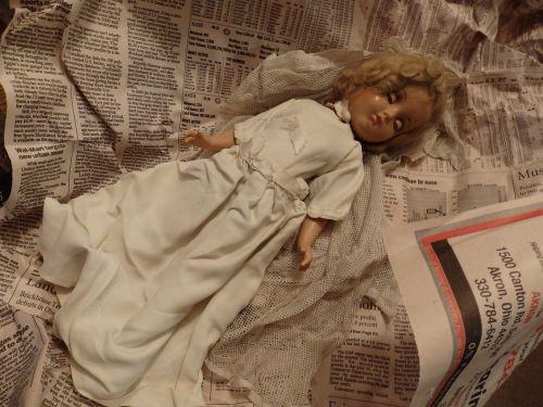 porcelain doll antique newspaper