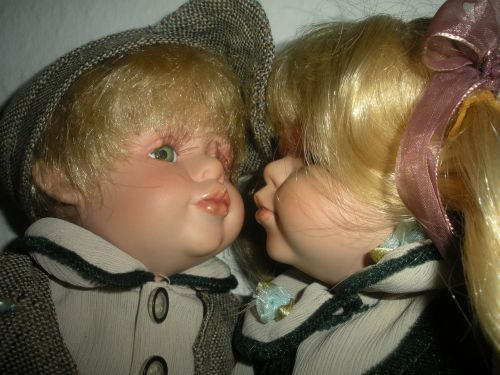 porcelain dolls kissing close-up