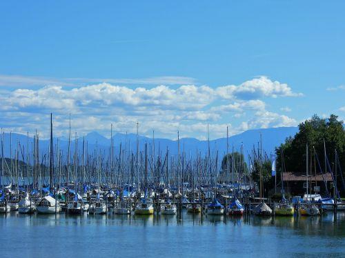 port sailing ships mountains