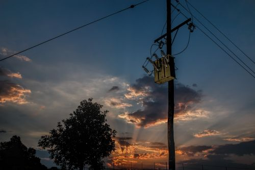 power line electricity transformer sunset