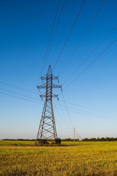 power lines grass fields