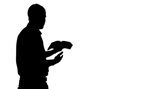praying man man reading the bible silhouette